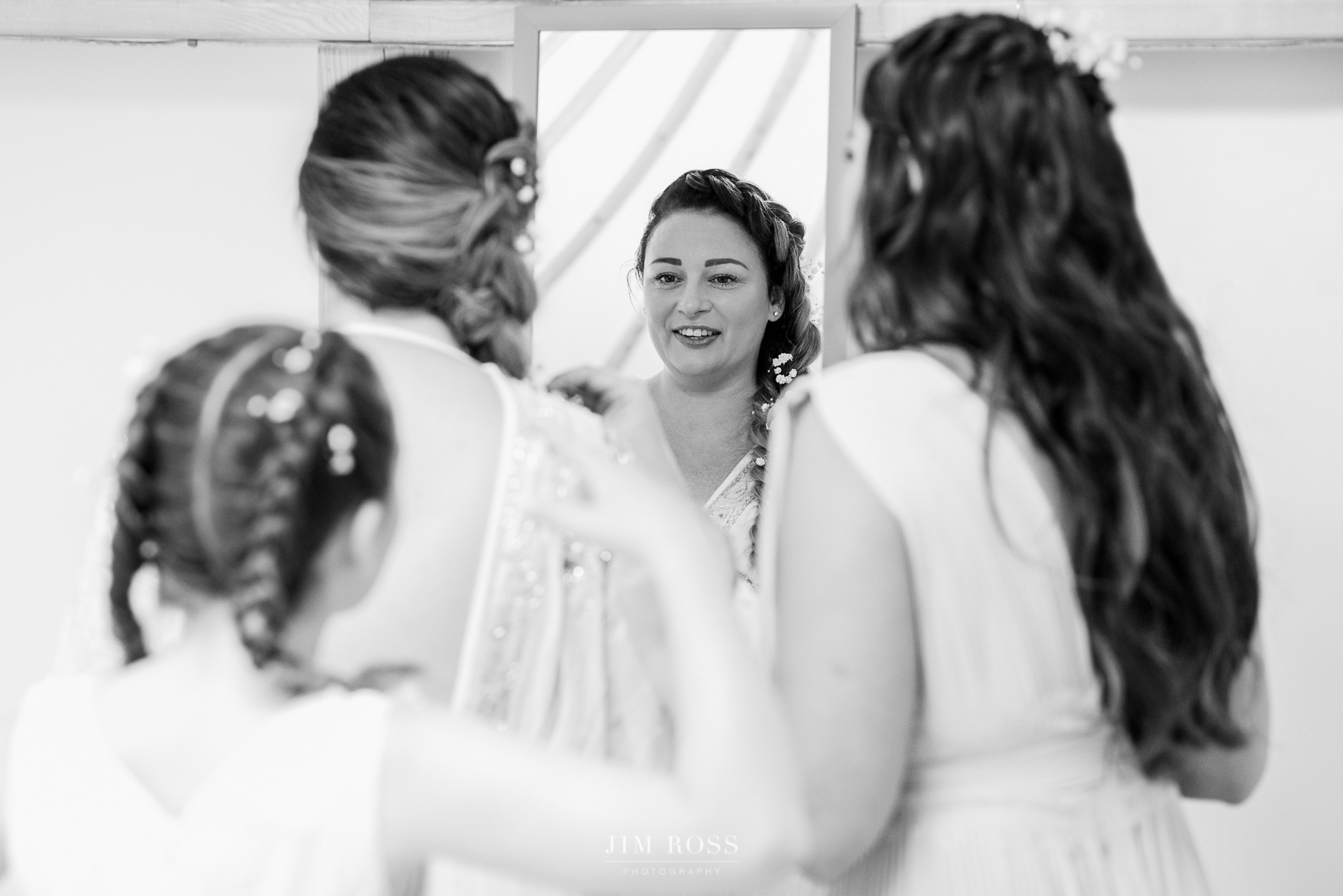 Bride with daughters finishing touches