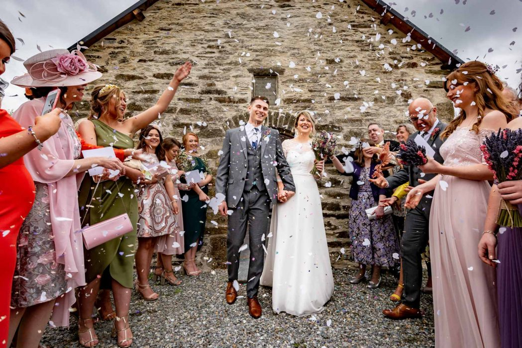 Welsh Yurt Wedding Photographer confetti exit at medieval chapel