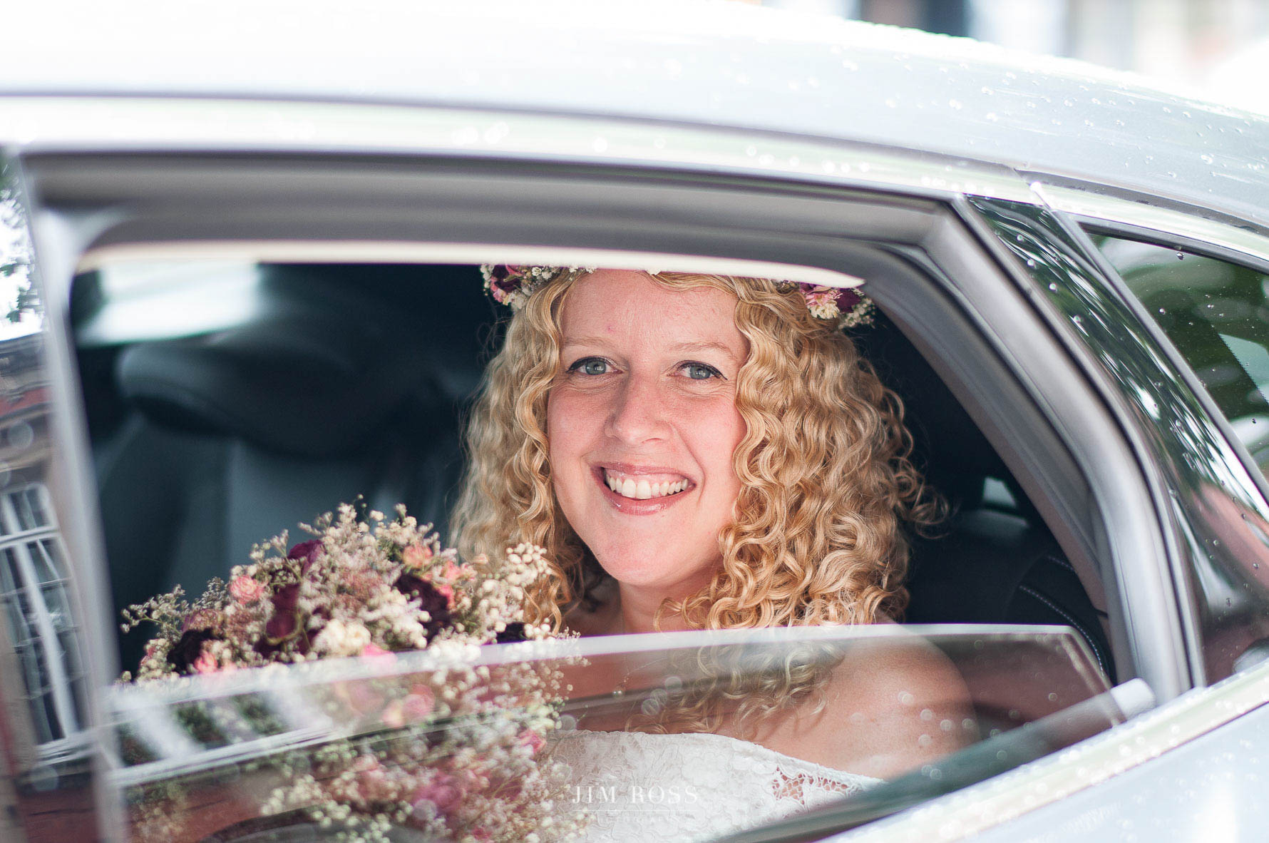 Bride arrives in car at Sale wedding