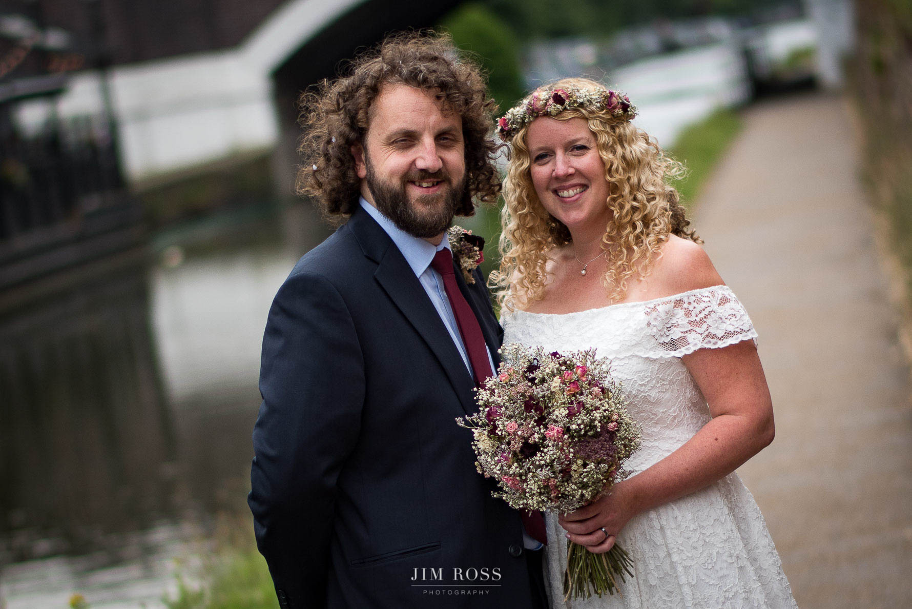 Newlyweds portrait by the canal