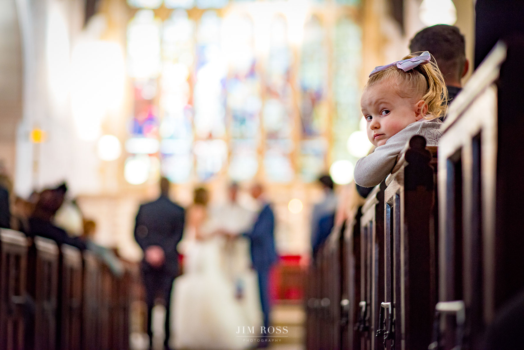Wedding guest child looking the wrong way