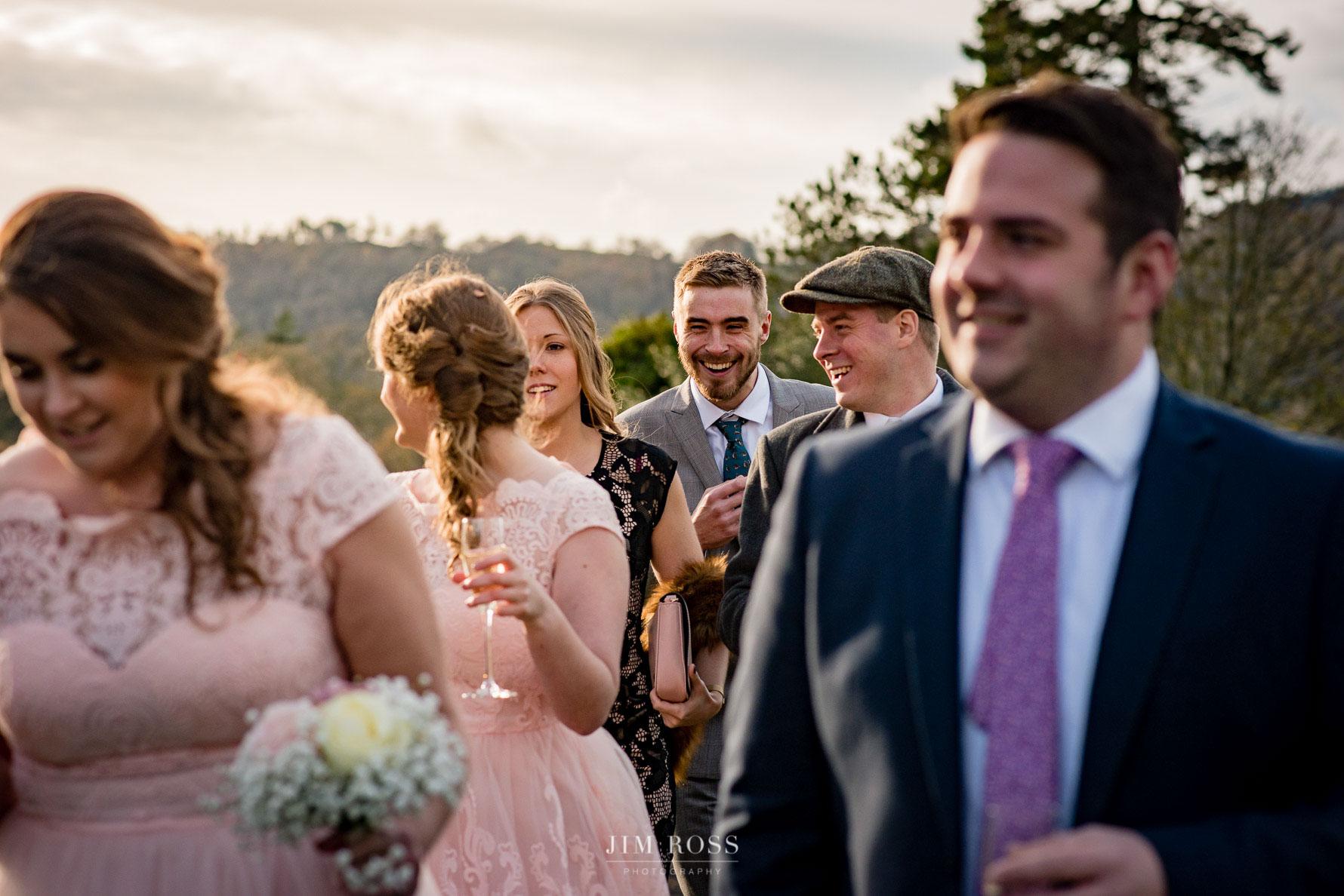 Wedding guests in golden evening light