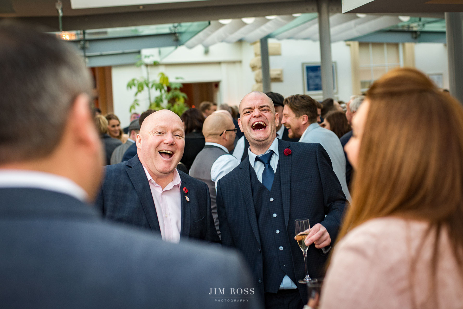 Guests enjoying canapes and laughter