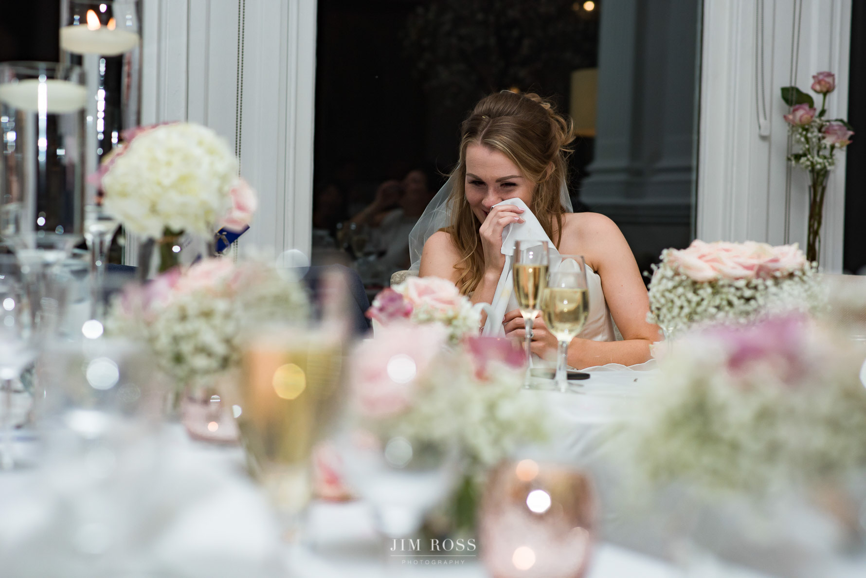 Bride crying with laughter in speeches