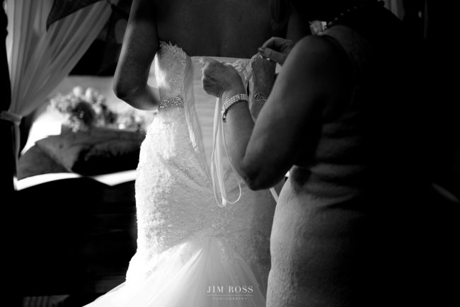 Fastening the back of wedding dress