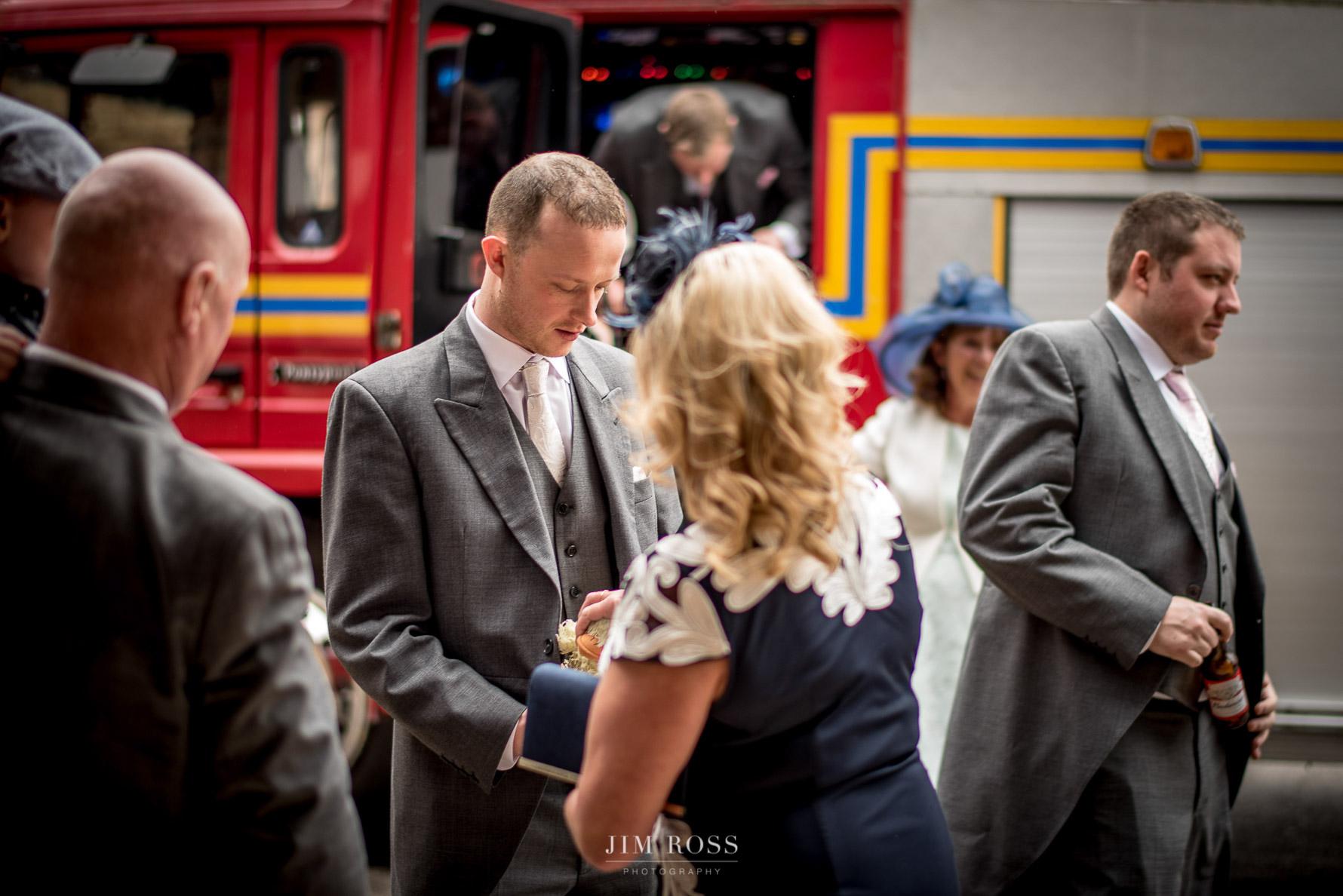 Groomsmen arrive in fire engine