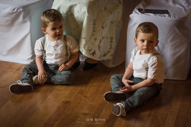 Twin toddler boys waiting for ceremony