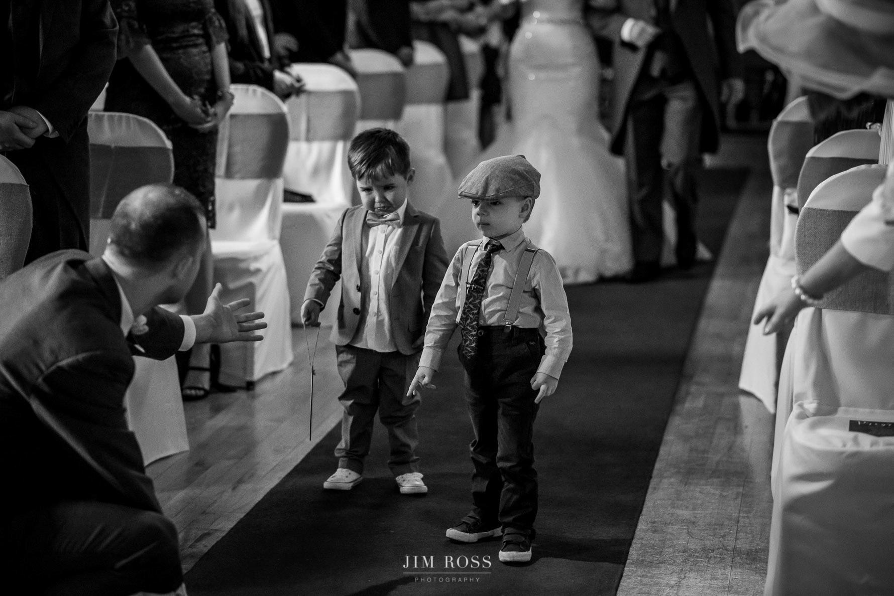 Page boys walk ahead of bride