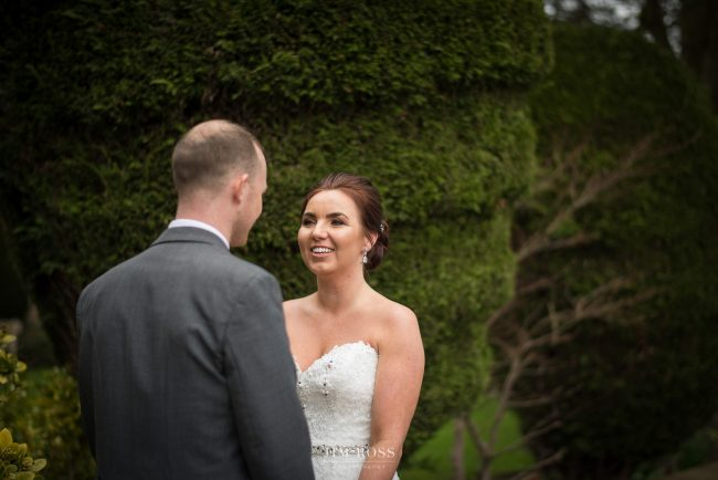 Happy new bride smiles at husband