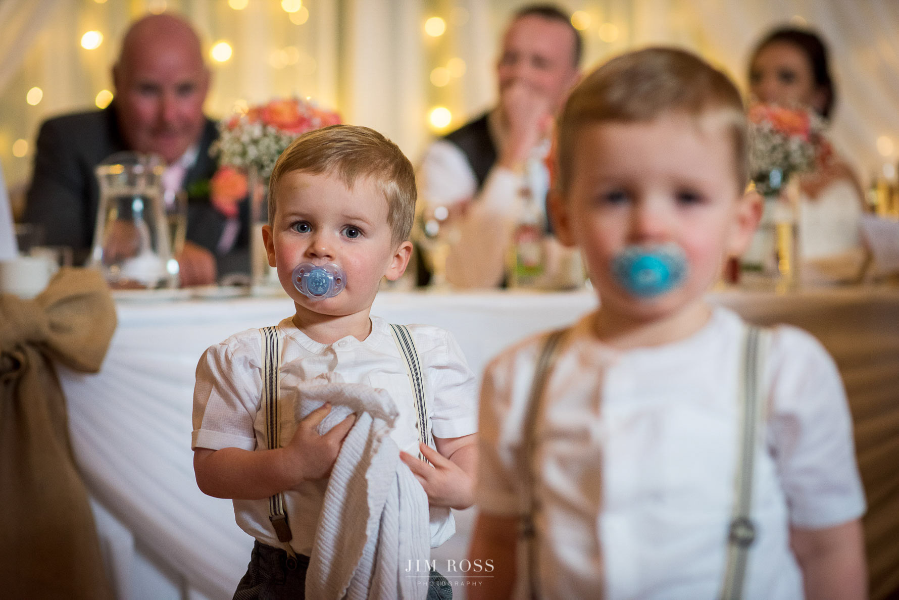 Twin boys during wedding speeches