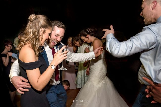 Wedding guests letting their hair down