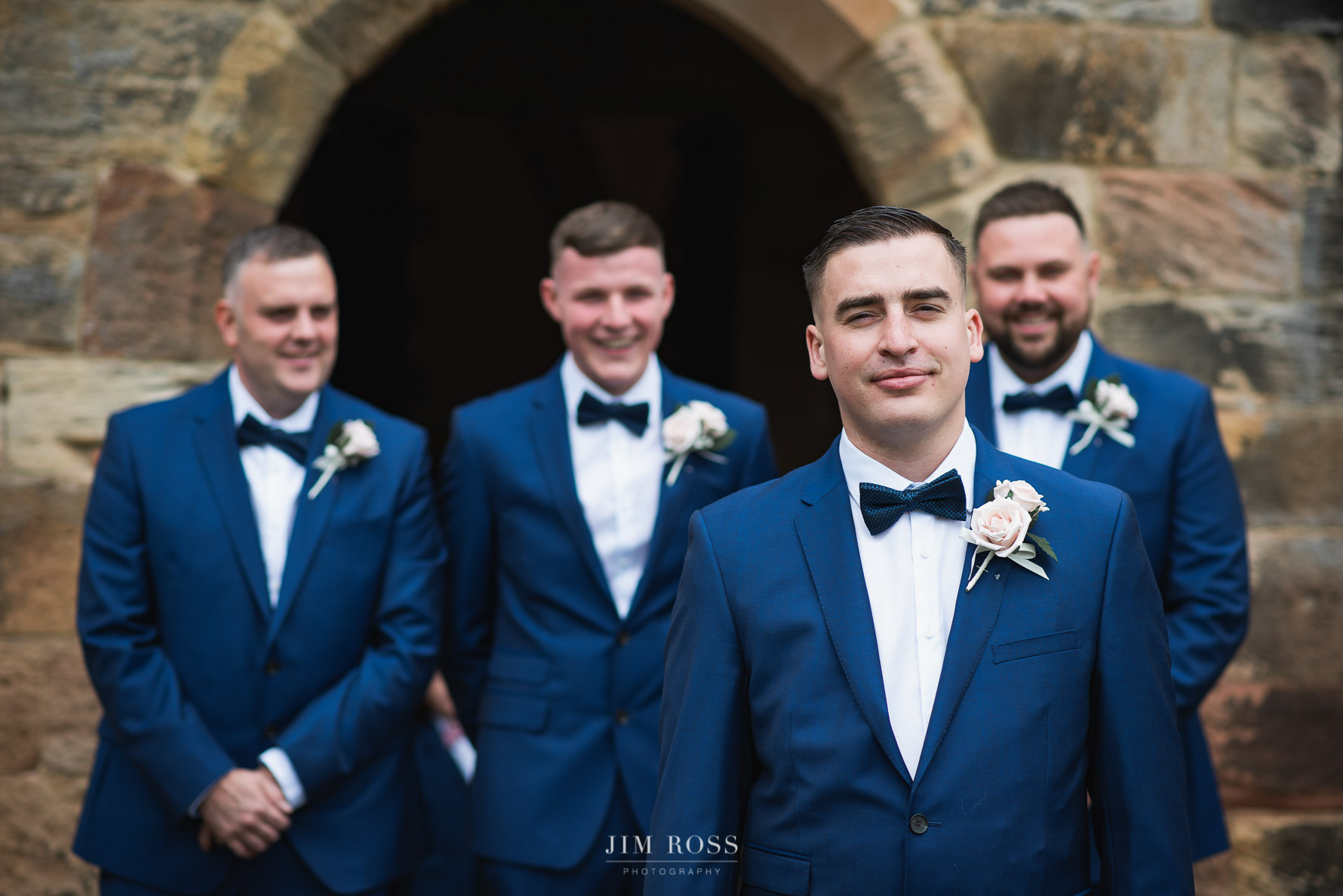 Groomsmen portrait outside Derbyshire church