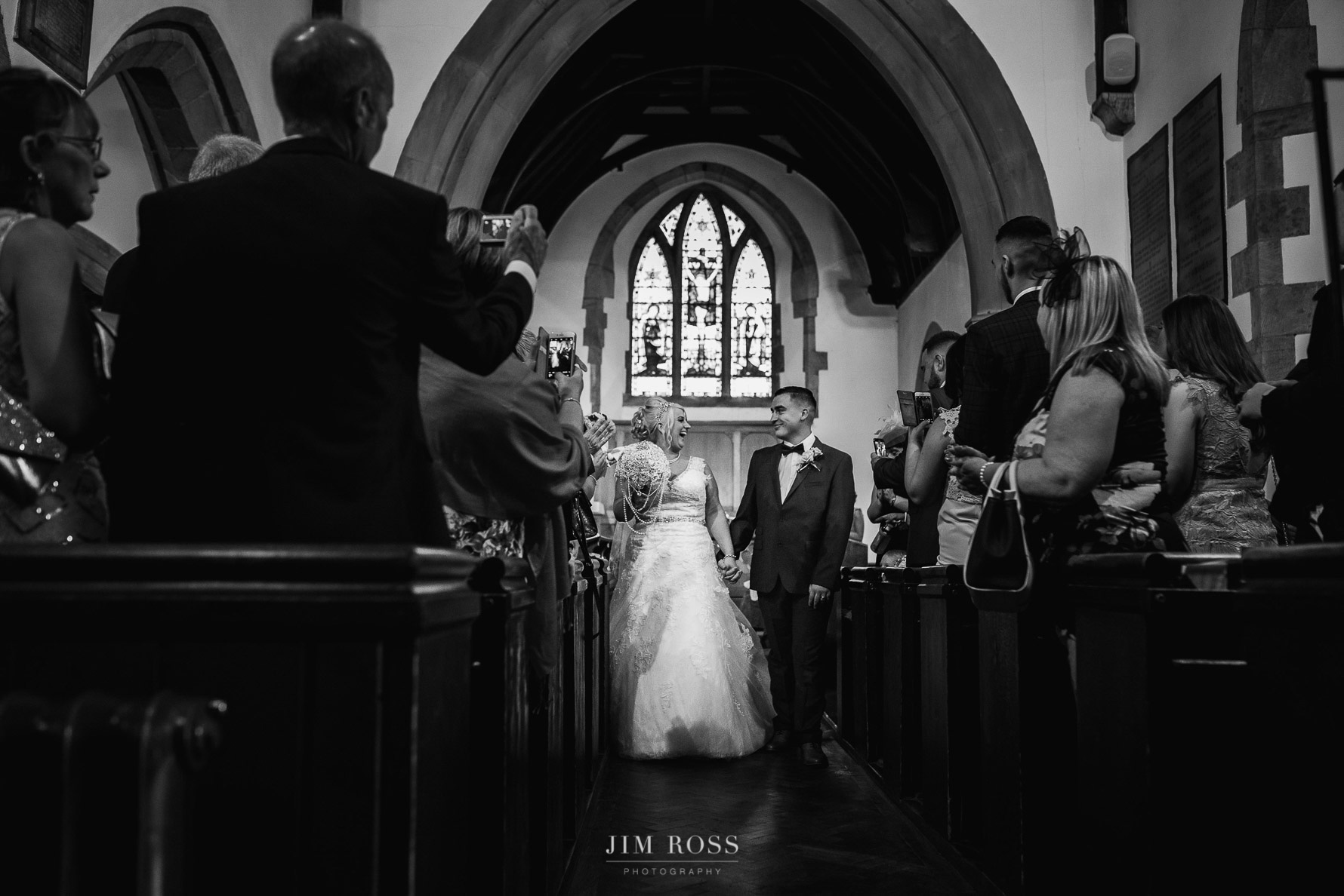 Newlyweds in church aisle
