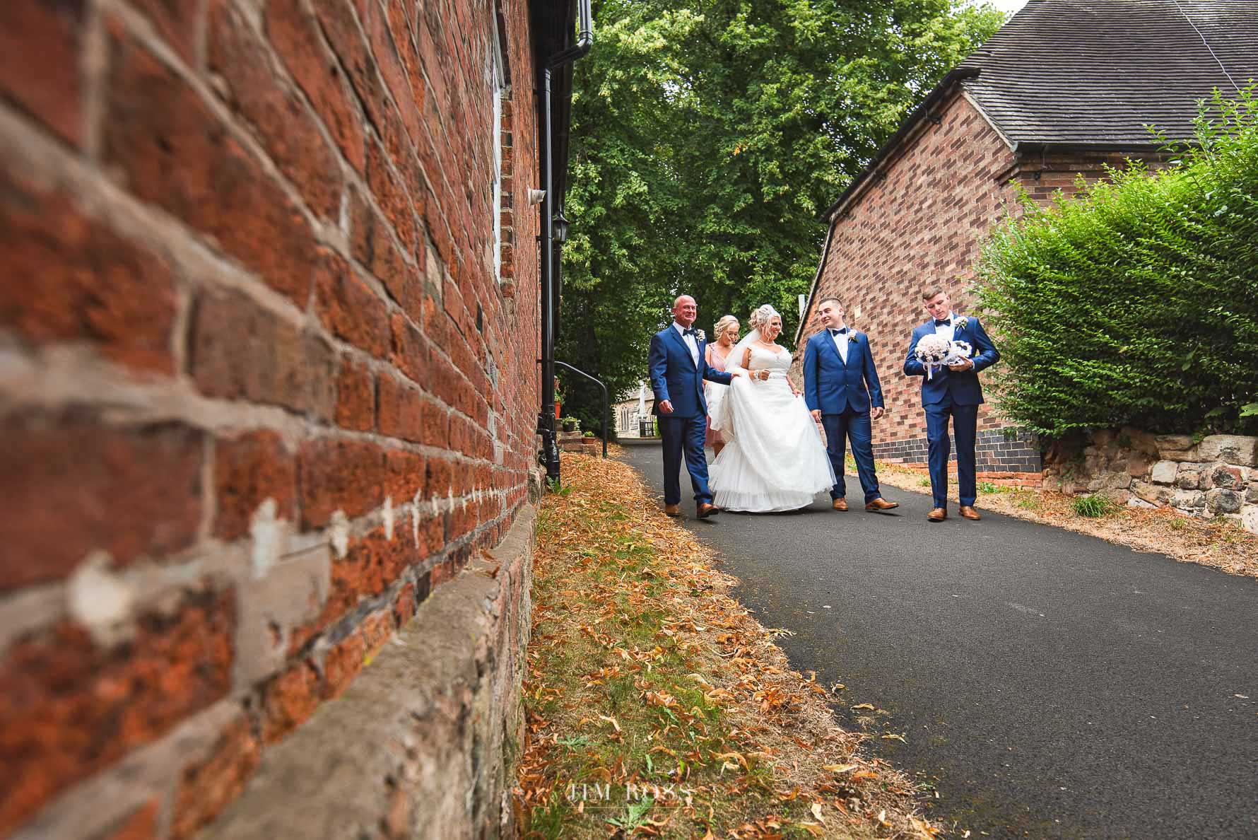 Newlyweds walk to the car