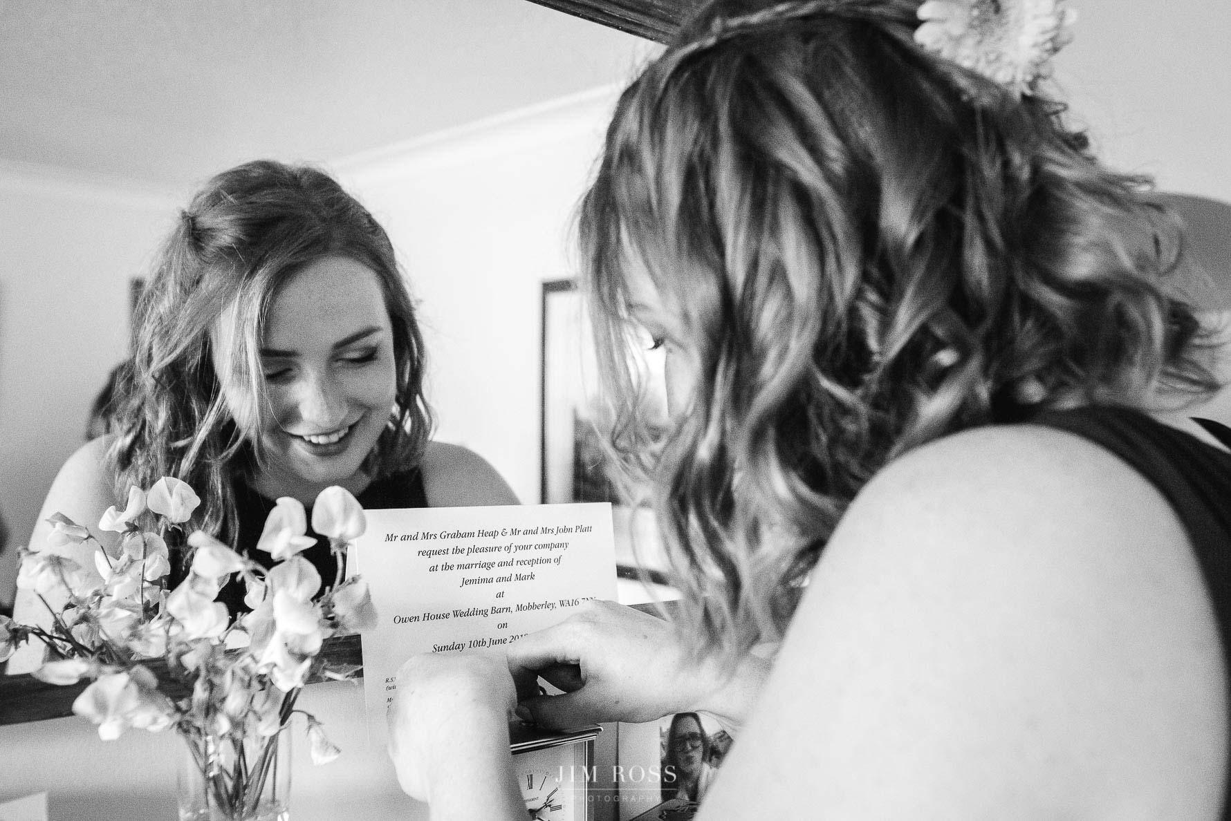 Bride's sister sorting earrings by wedding invite
