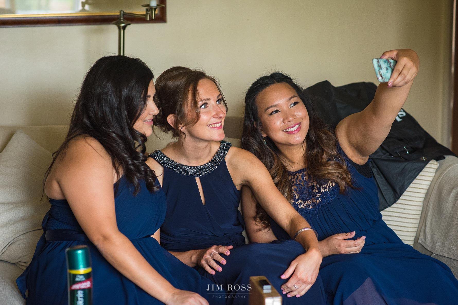 Bridesmaids selfie on sofa