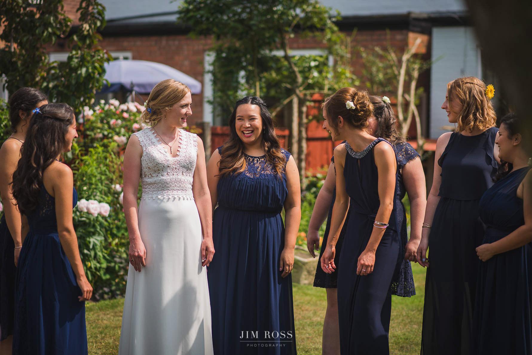Admiring elegant bridal dress