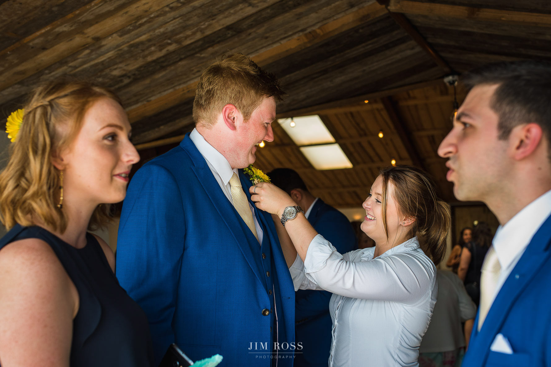 Groomsmen prep in Wedding Barn foyer