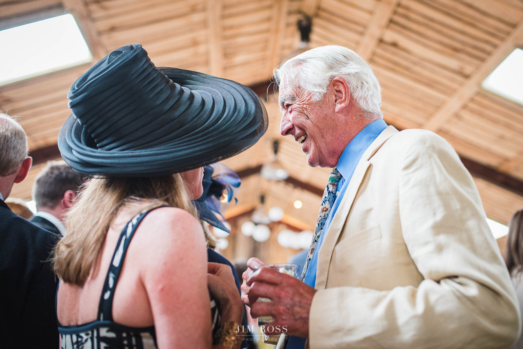 Hats and laughs in wedding barn