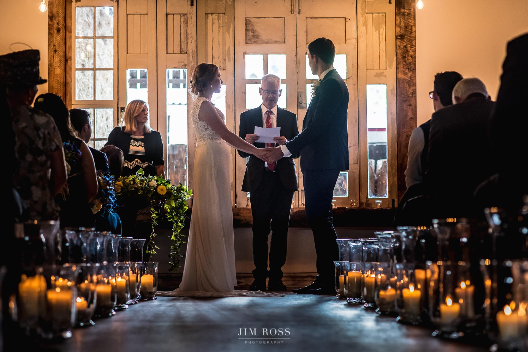 Couple exchange vows at Owen House Wedding Barn