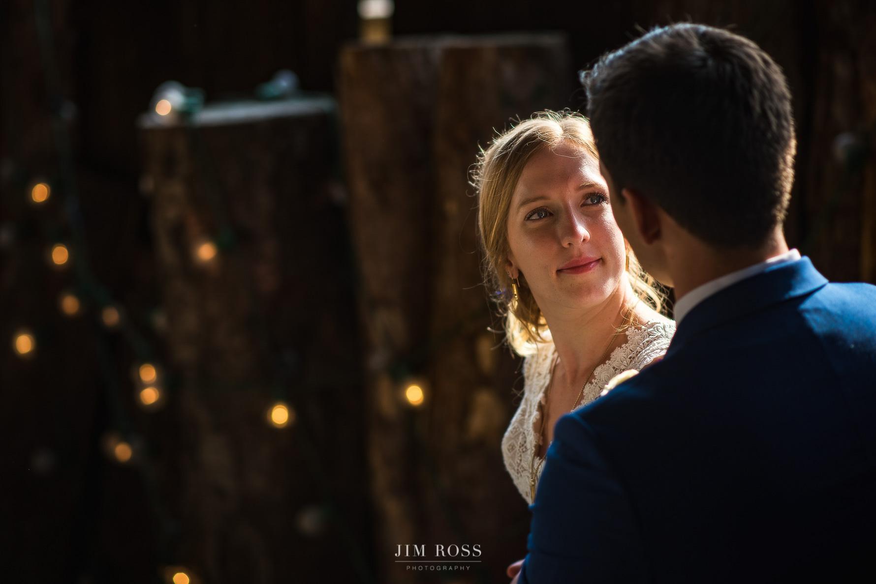 Bride looks lovingly at new husband
