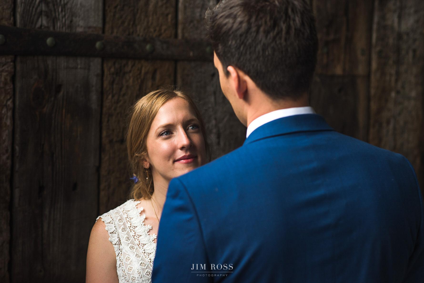 Couple portrait by barn door