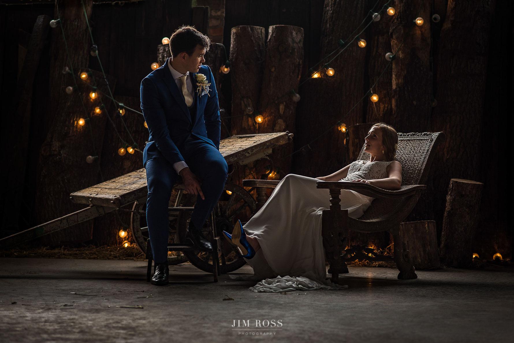 Elegant couple in rustic wedding barn