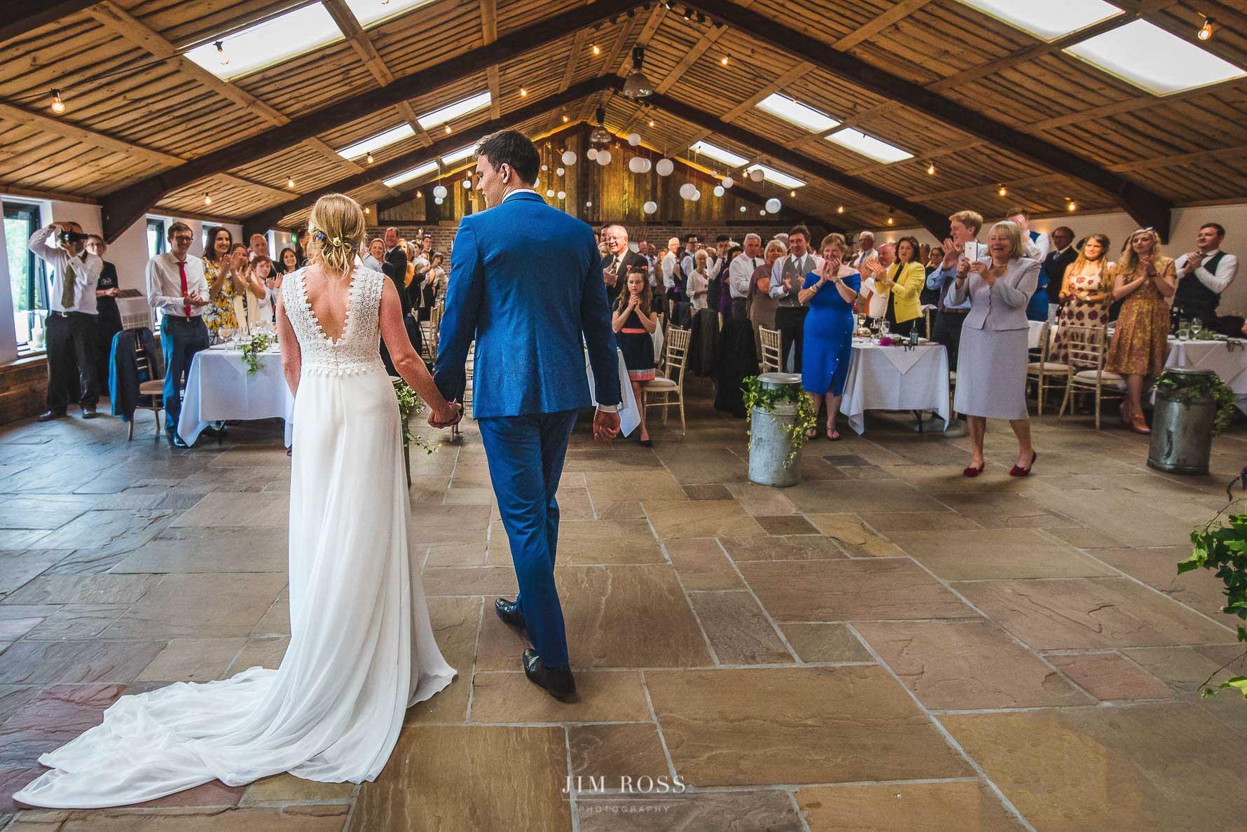 Newlyweds arrive at wedding breakfast