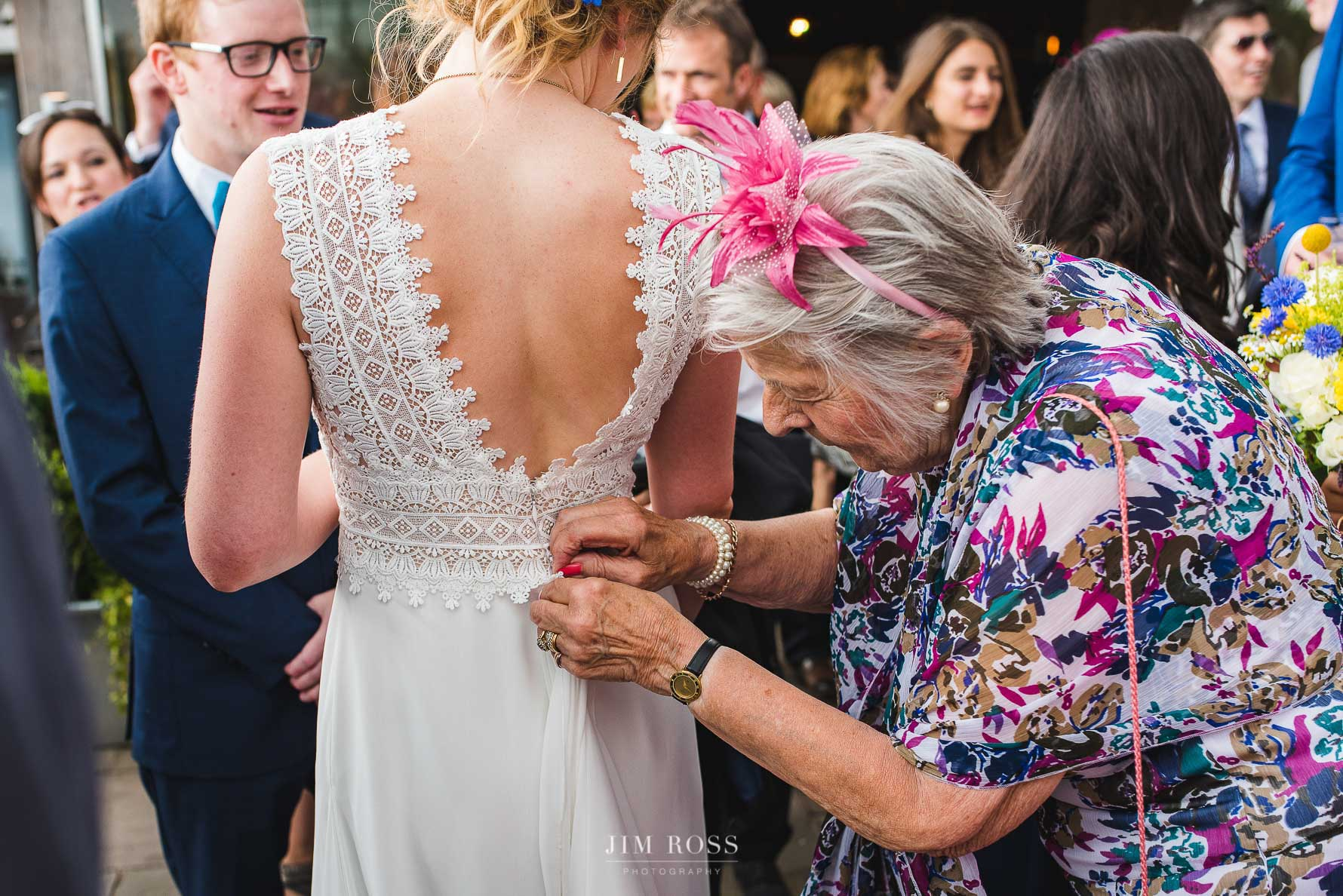 Quick adjustment of elegant bride dress