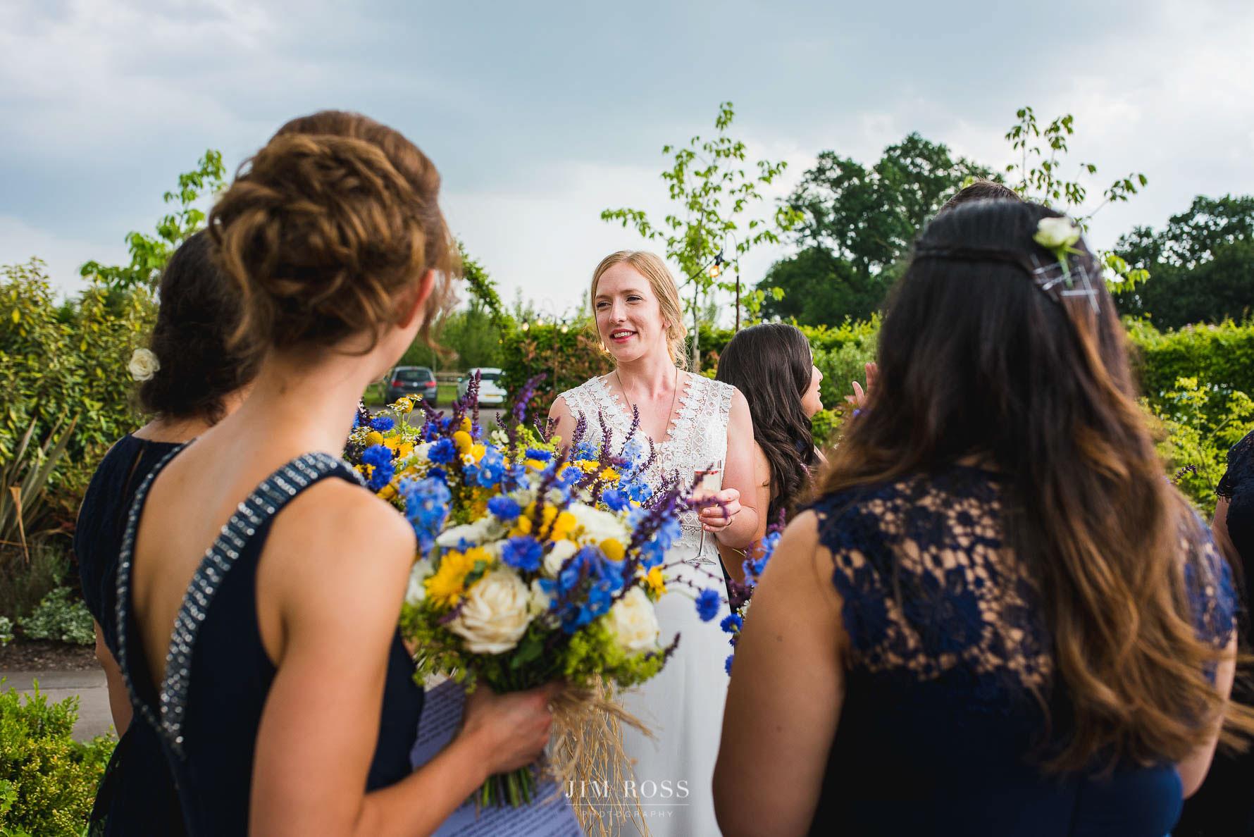 Bride and bridesmaids in Wedding Barn gardens