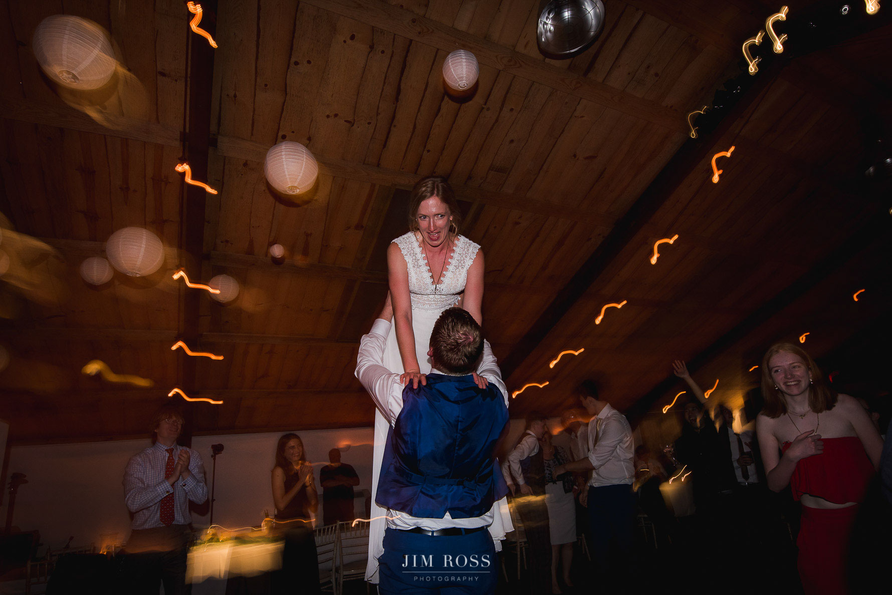 Bride being lifted on the dance floor