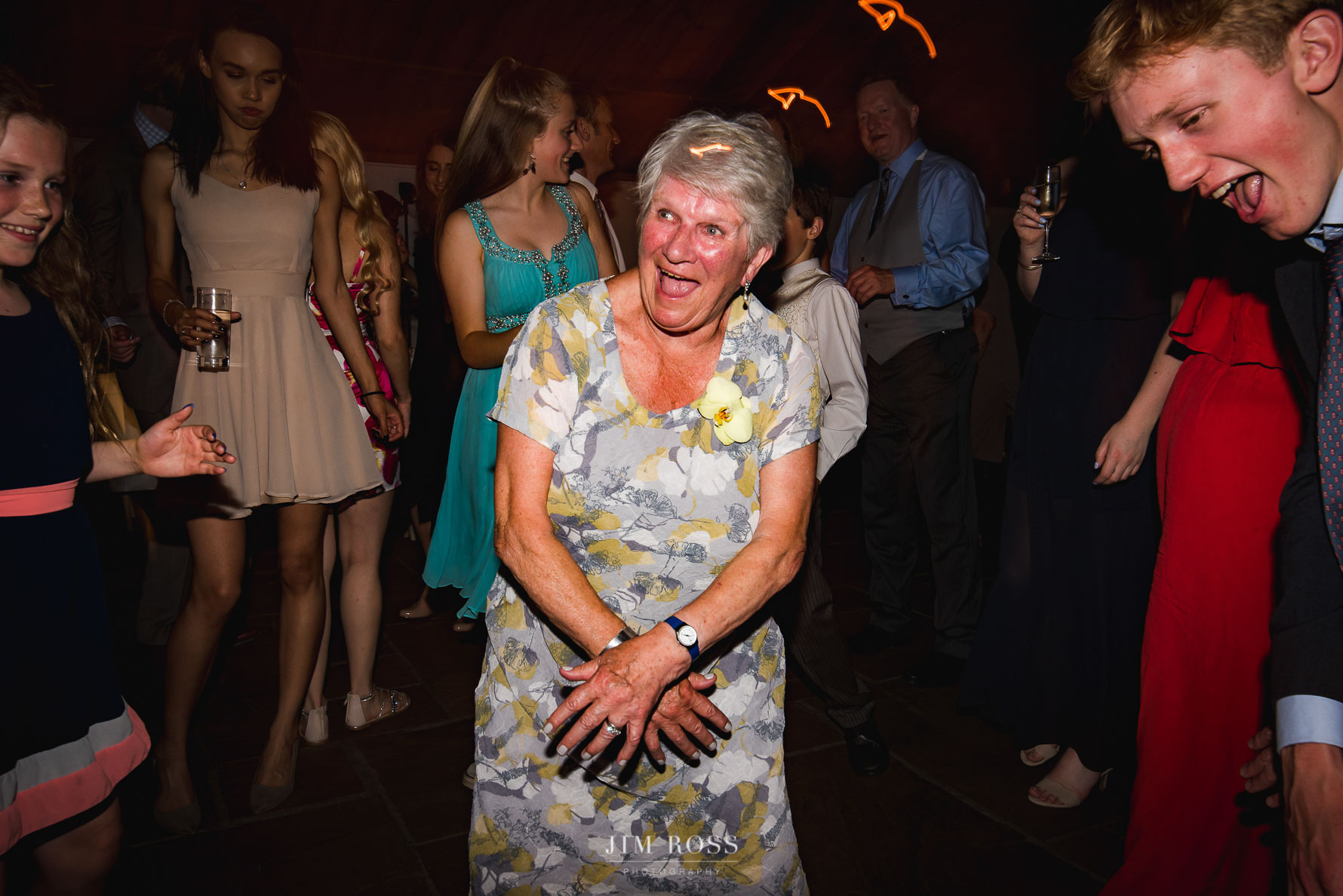 Gran dancing with youngsters