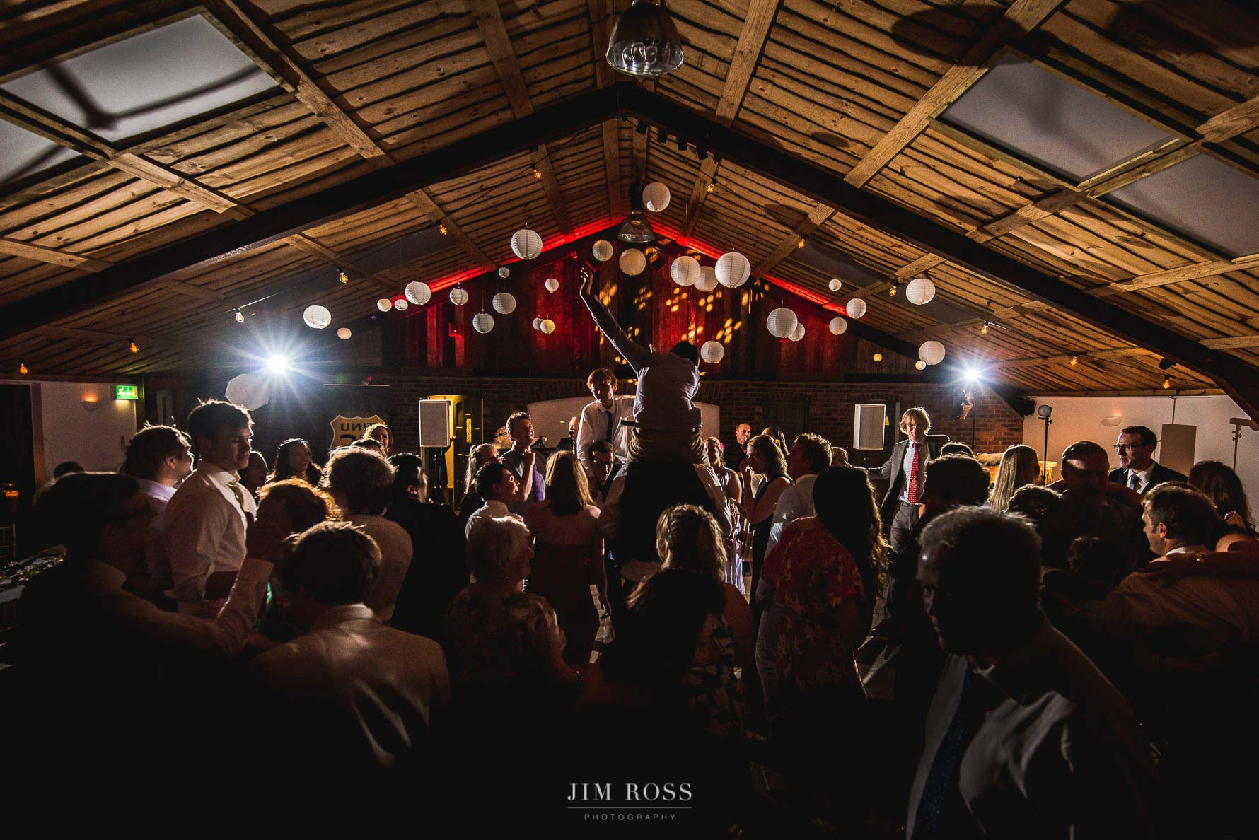 A packed dance floor at Owen House Wedding Barn