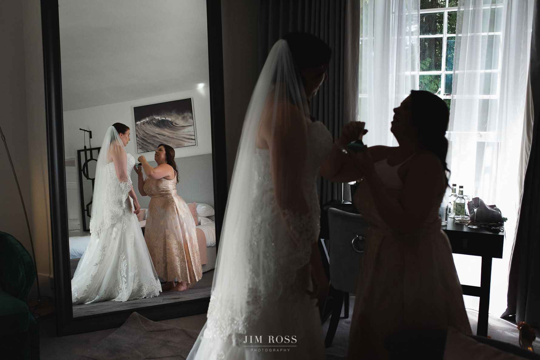 Bride and sister in mirror and silhouette