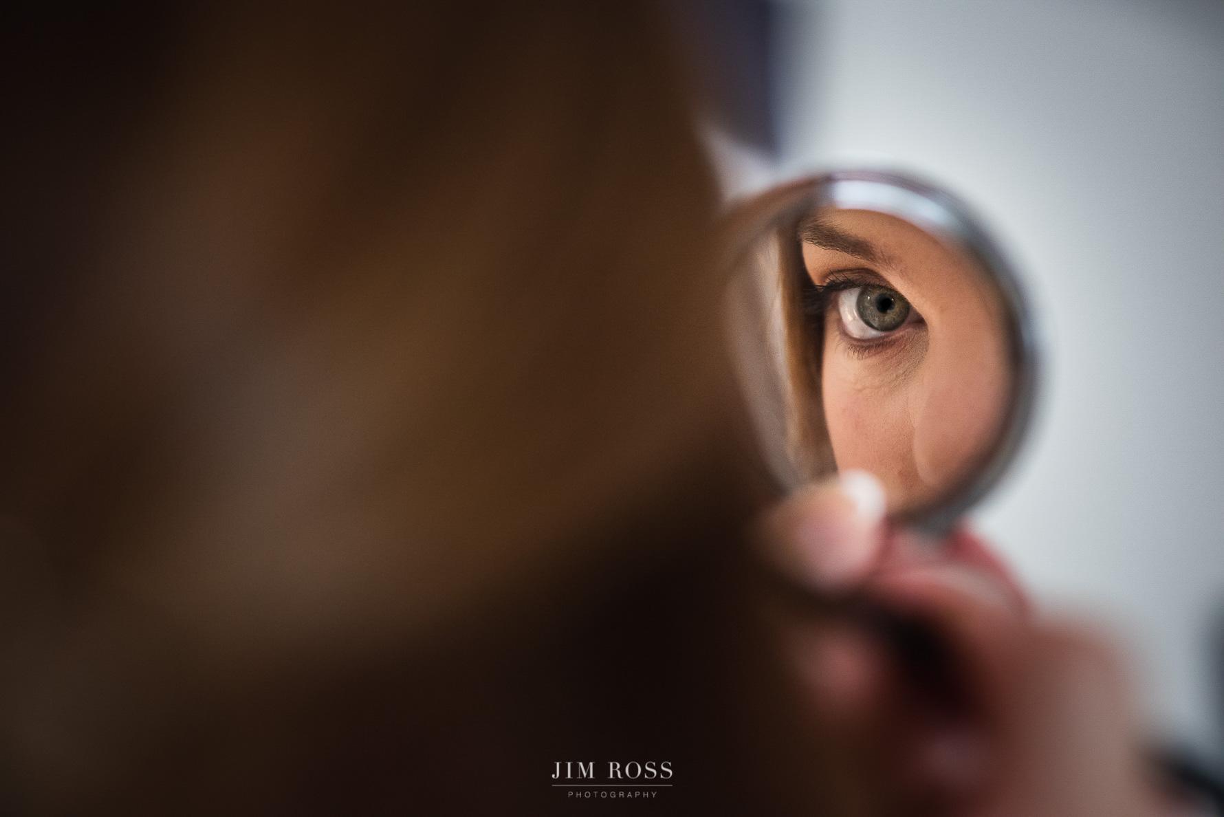 Makeup mirror eye close-up