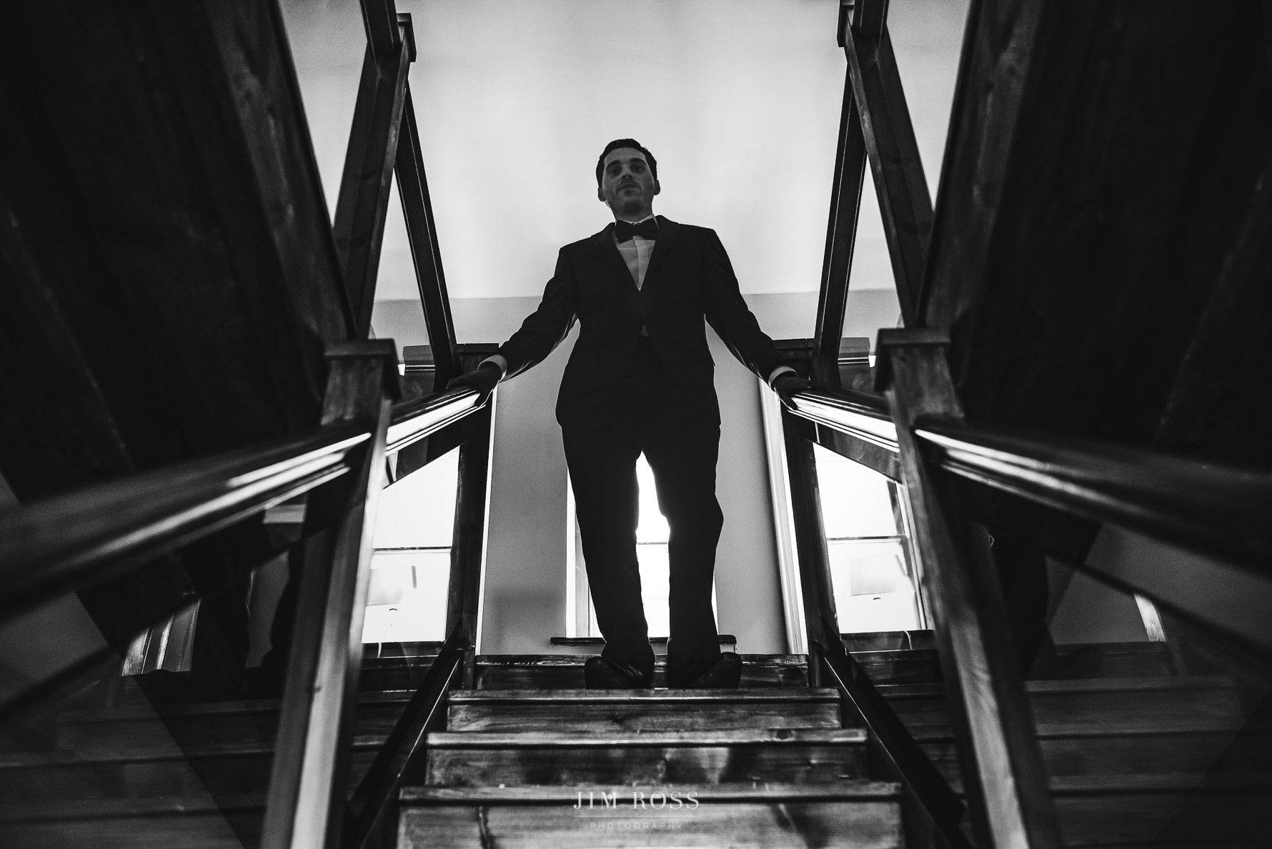 Groom descends stairs
