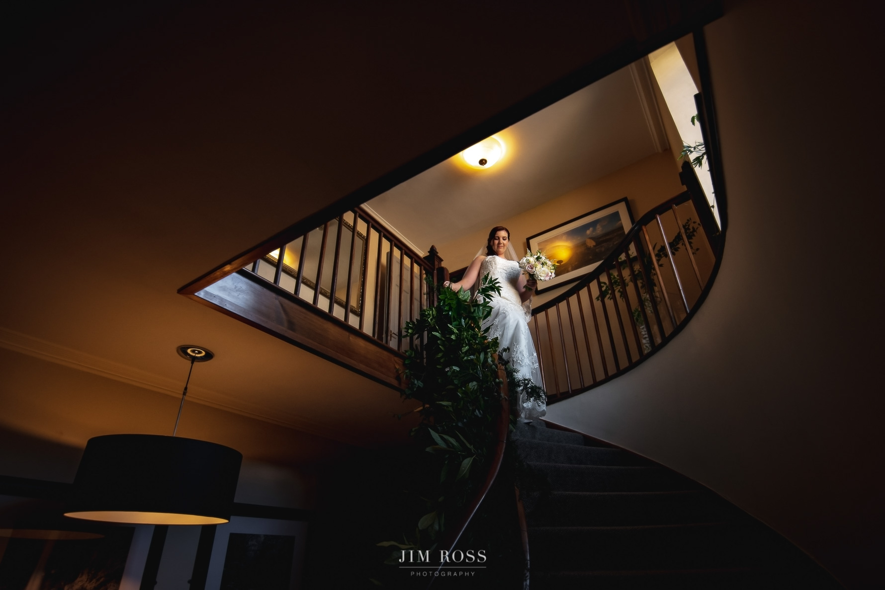 Bride descends staircase at Fairy Hill