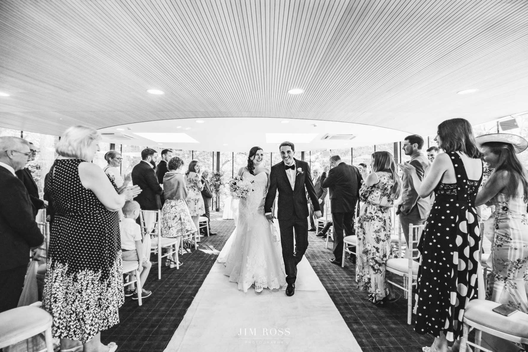 Newlyweds walk down aisle in K Room