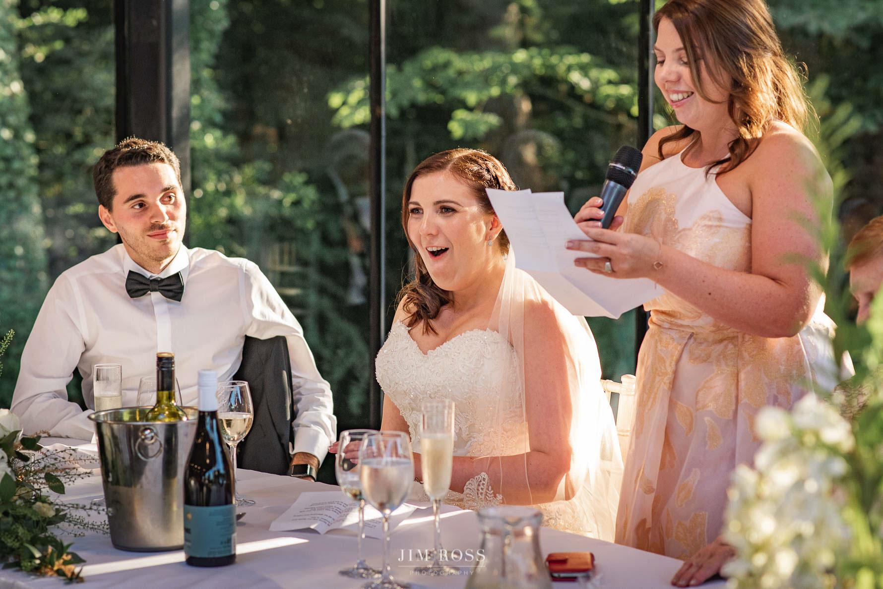 Bridesmaid makes bride blush