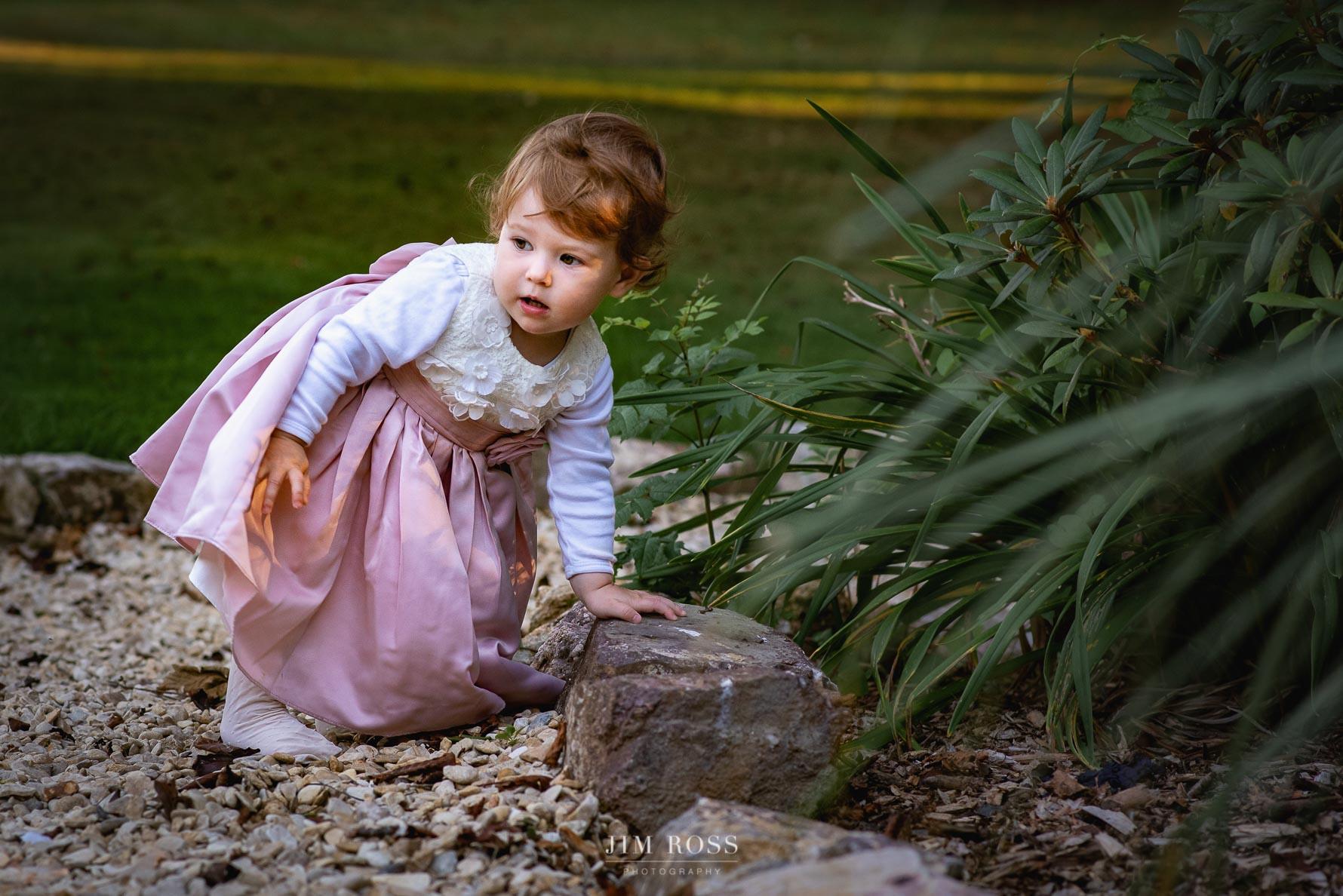 Toddler exploring Fairy Hill gardens