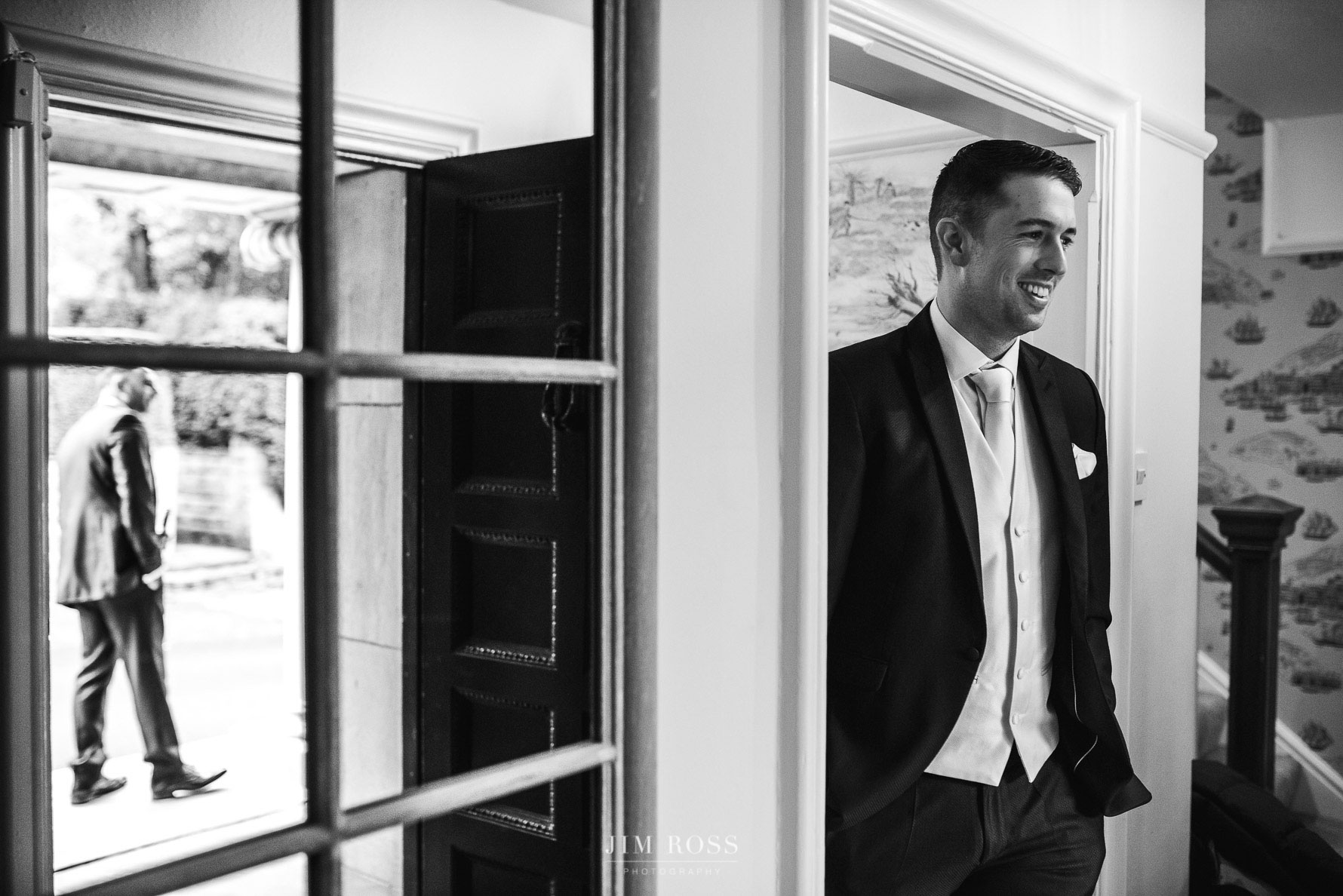 Groom looks out to best man