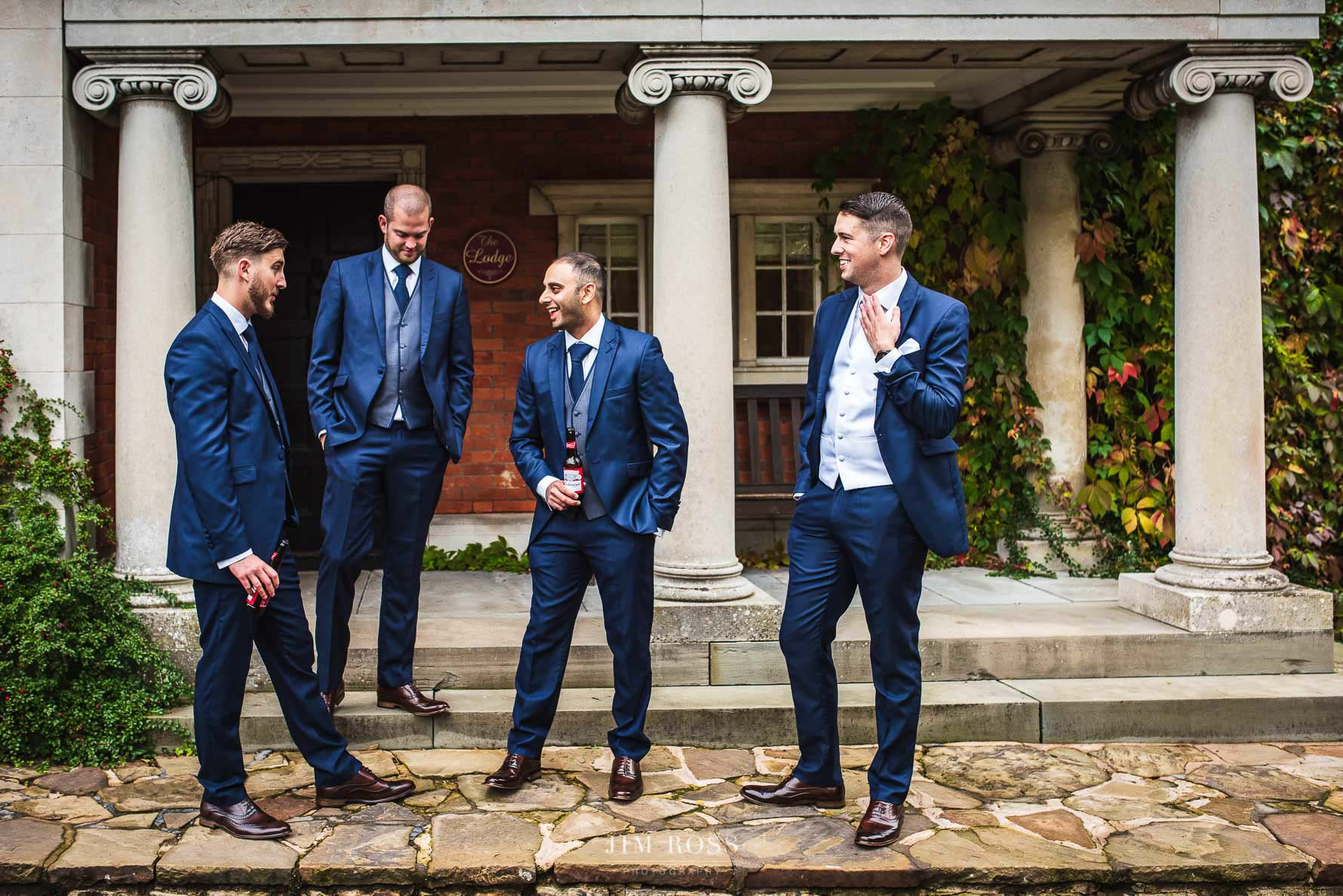 Groomsmen sharing a beer