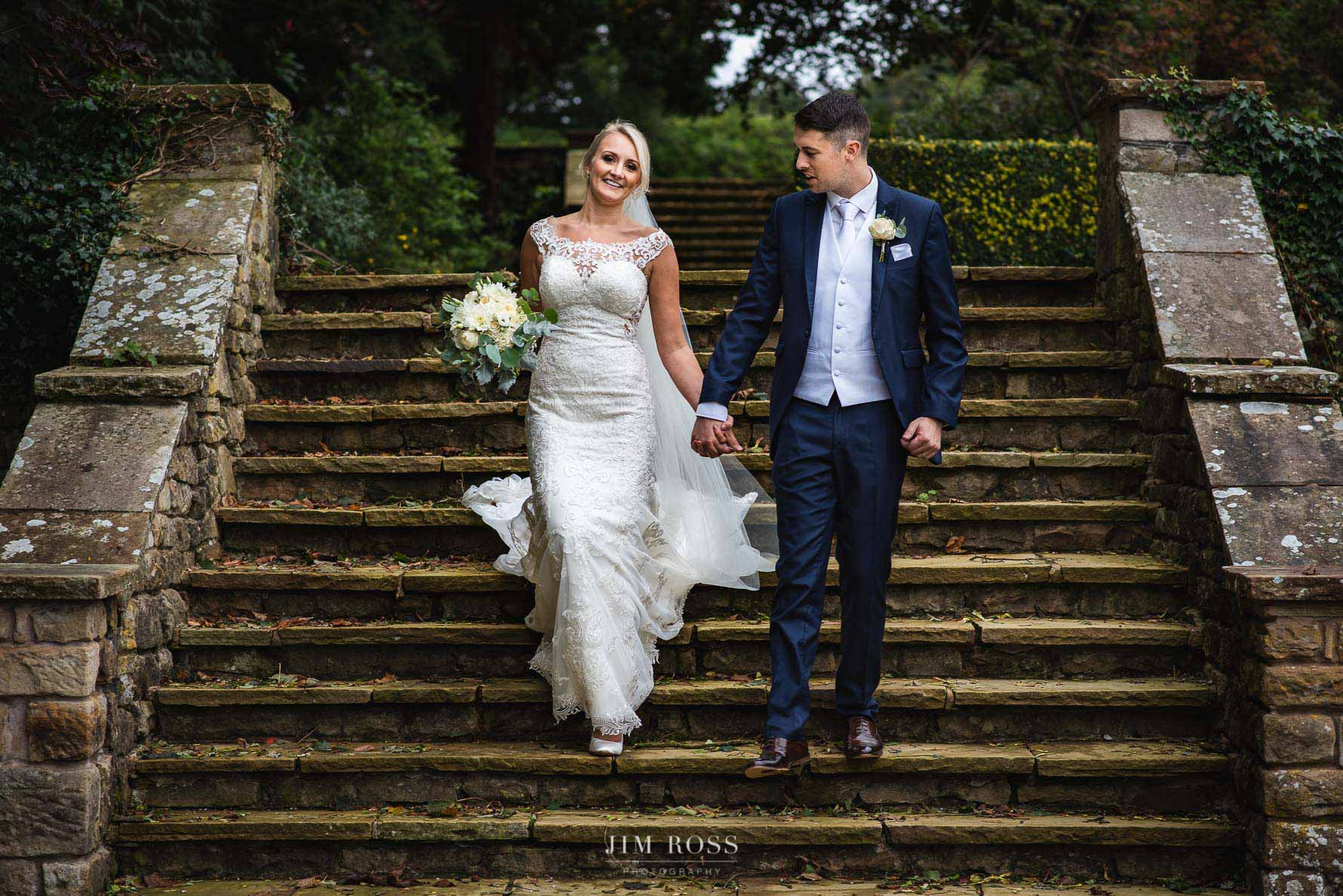 Couple walk in Eaves Hall gardens