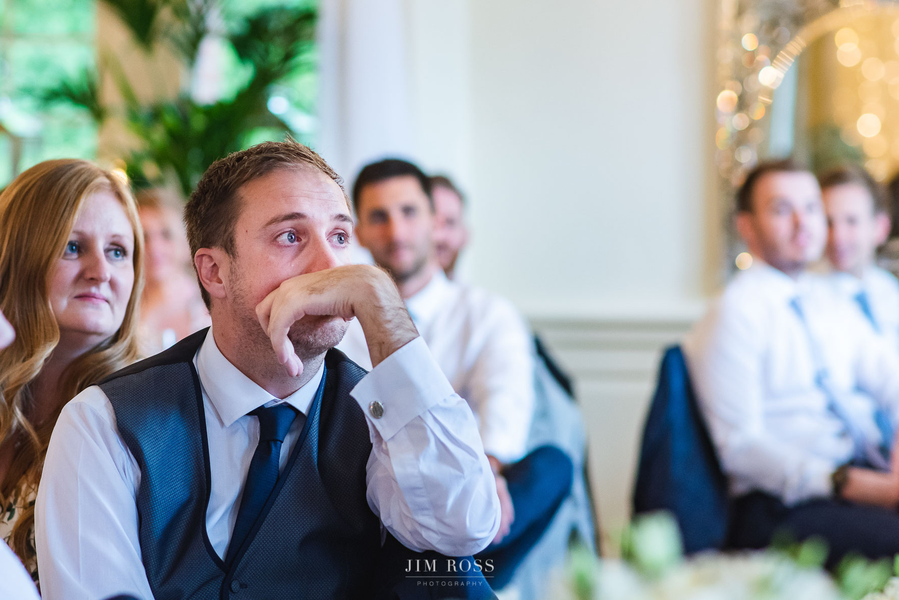 Brother of the groom sheds a tear