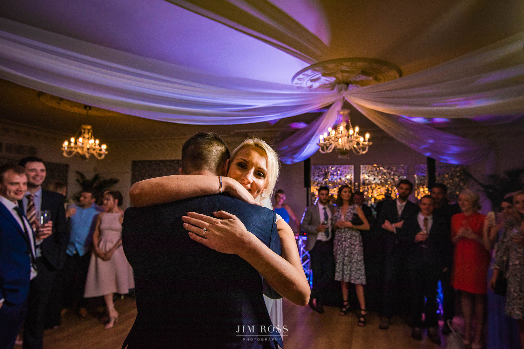 First dance hug under opulent Eaves Hall decorations