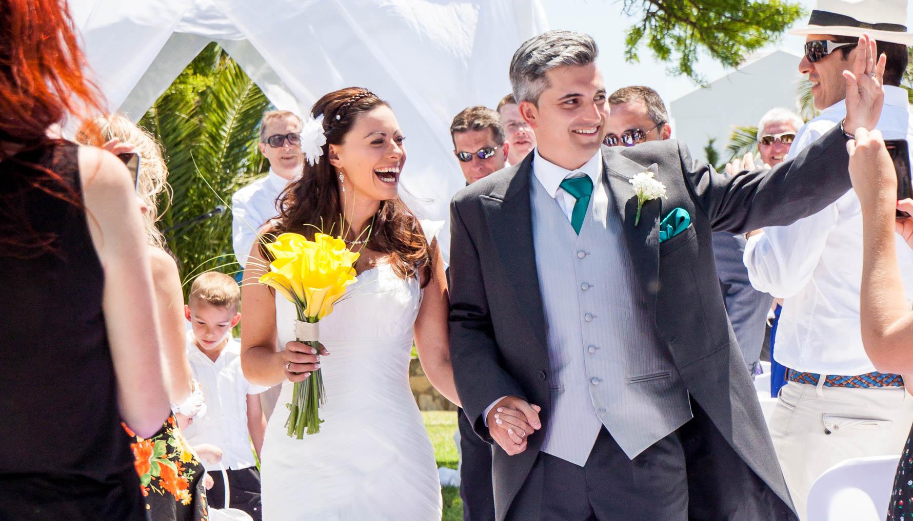 Happy couple walk down the aisle