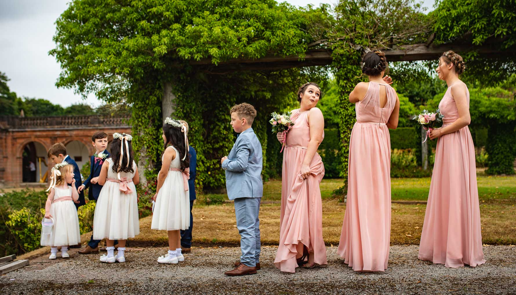 Lineup of bridal party and a cheeky joke