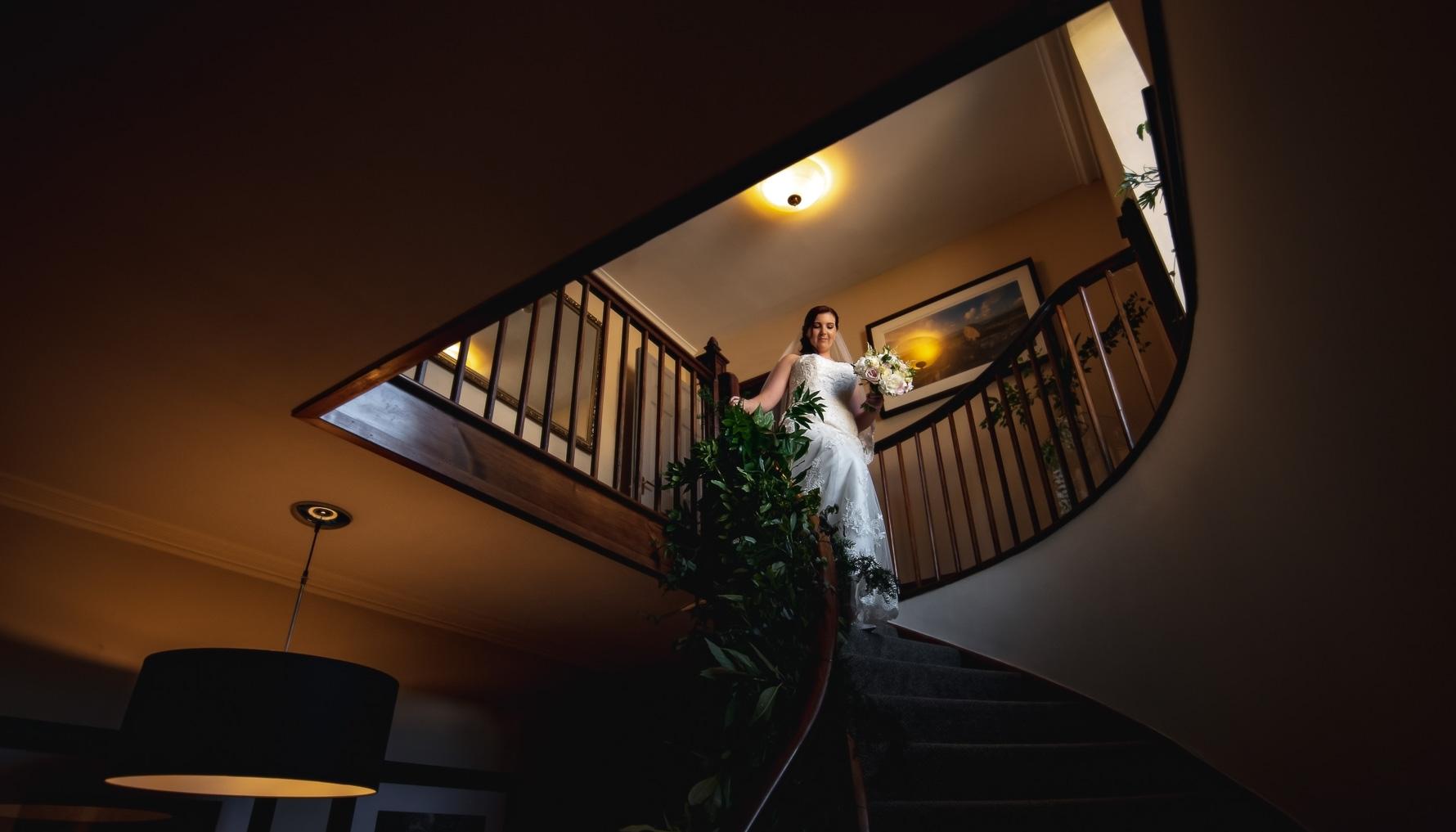 Bride-to-be descending staircase