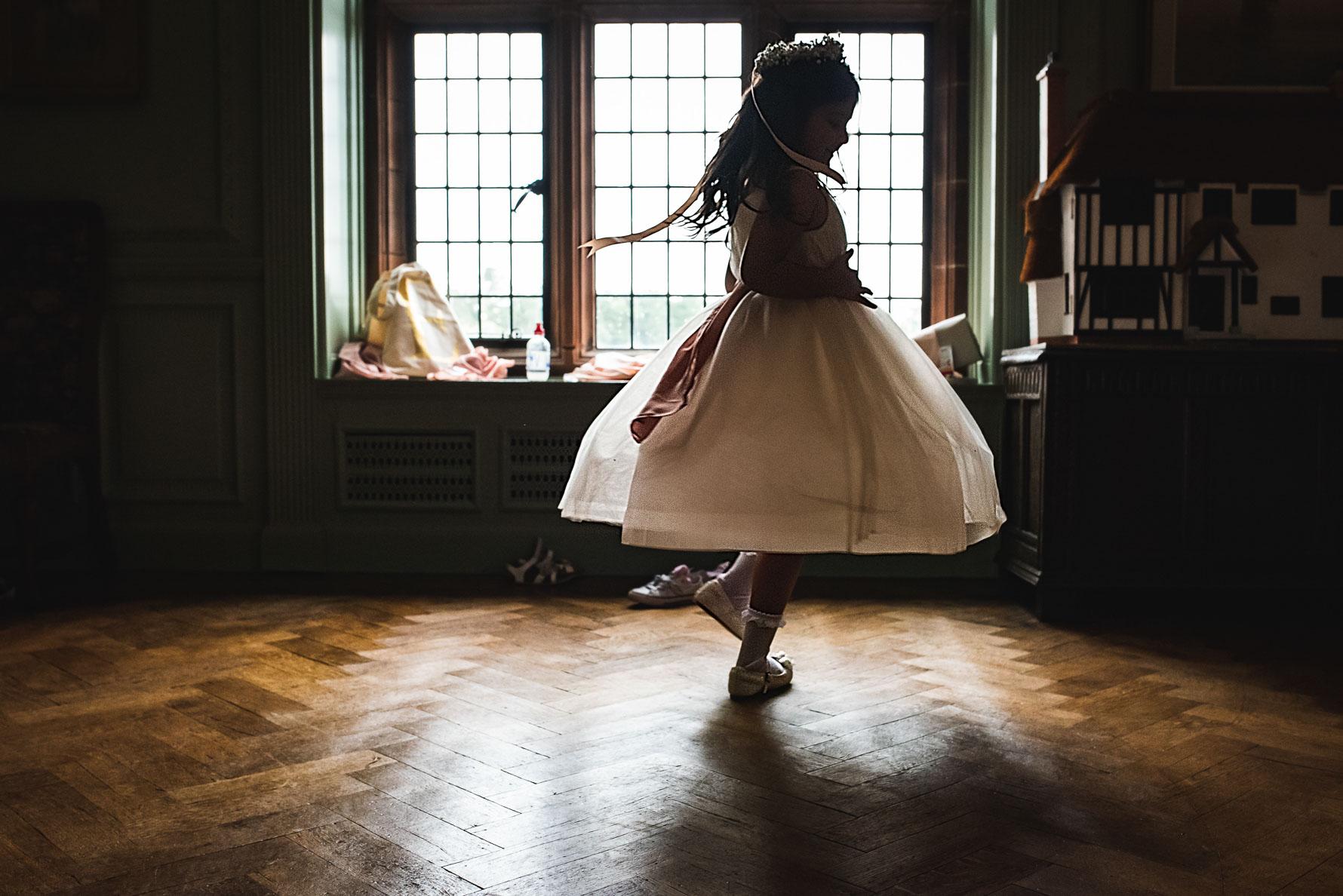 Flower girl dancing in wedding venue