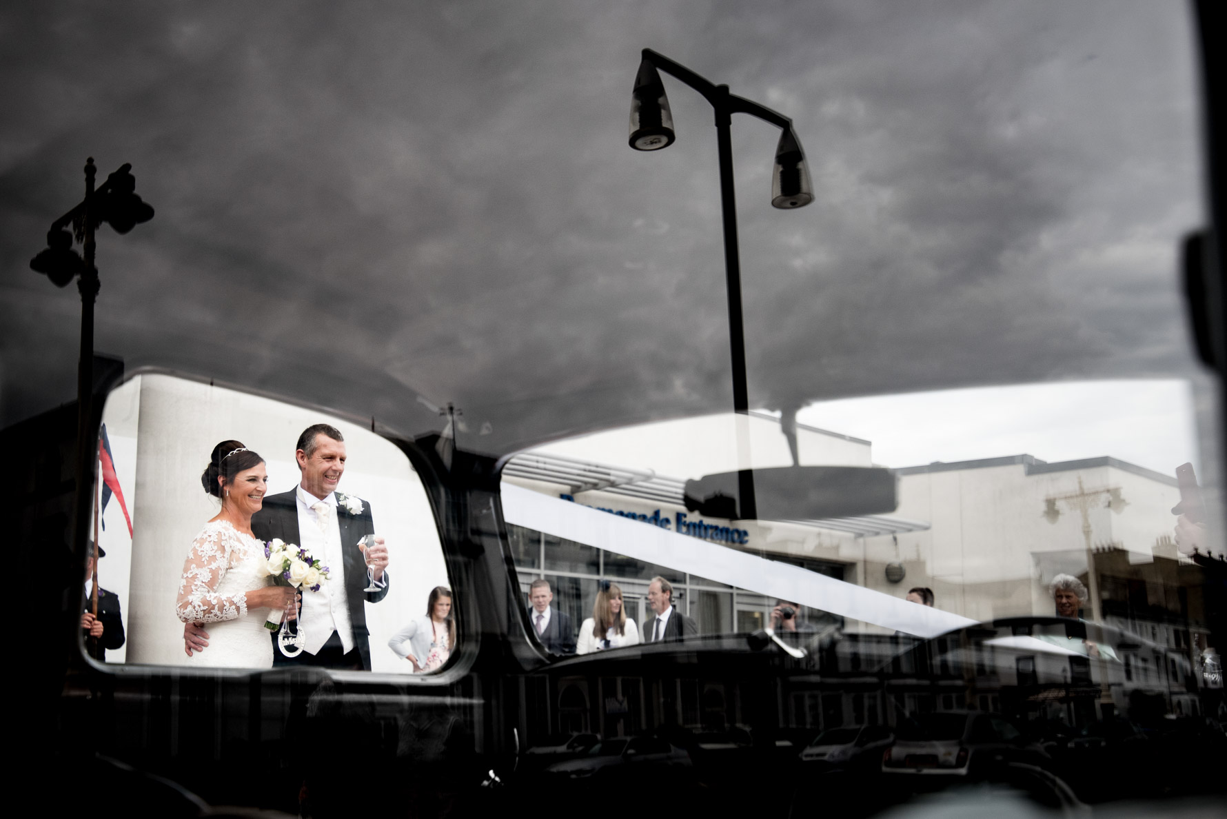 Couple through bridal car window
